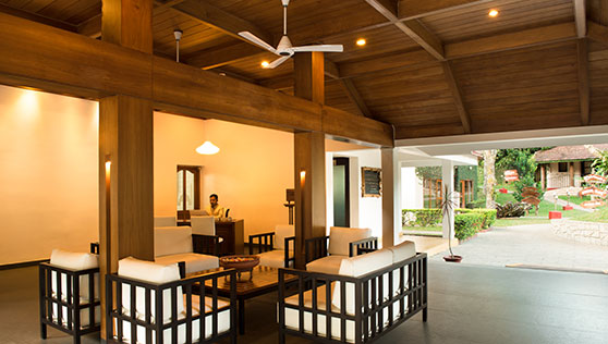Reception with friendly seating and open plan design at Cardmom County Thekkady India