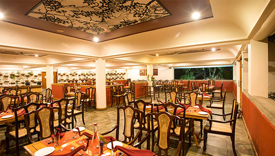 Restaurant and dinign area inside Cardamom County resort Thekkady India