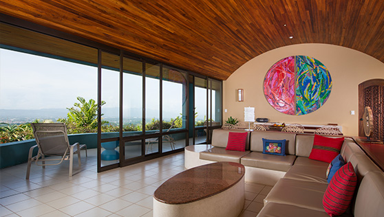 Living area with colorful art and view of the San Jose valley