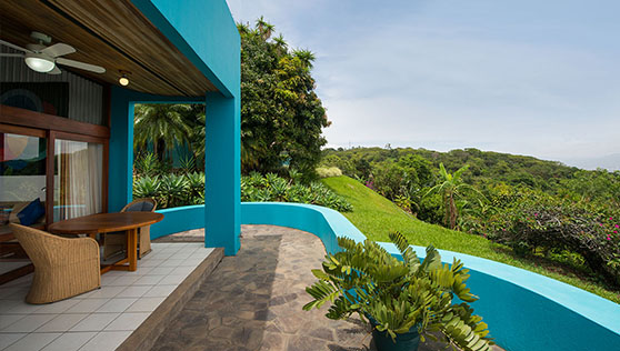 Private balcony with open expanse of rainforest valley and San Jose town
