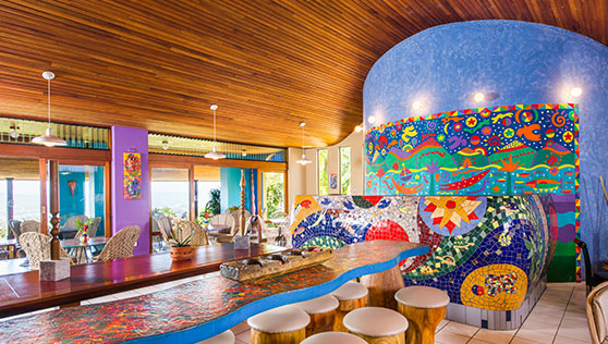 Restaurant and bar interiors with colorful art and sculpture
