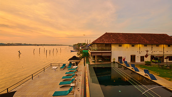Sunset view of the harbour and heritage boutique hotel Fortkochi India