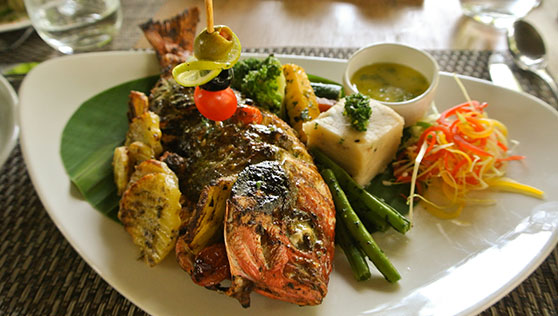 Fresh seafood prepared with local spices Kerala India
