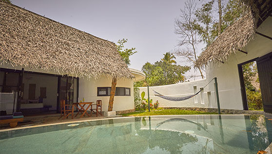 Private pool villa at beach resort Kerala India