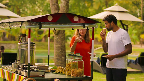 Tea stall and local snacks near the pool every evening at beach resort Kerala